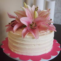 Cake With Fresh Flowers Coconut cake with vanilla buttercream.