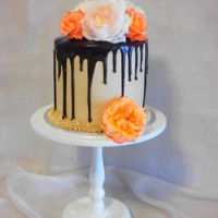 Chocolate Drippy Cake A chocolate cake with coffee buttercream and a ganache drizzle, decorated with fresh roses.