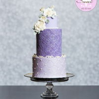 Christmas Purple Wedding Featured Cake Central Magazine Vol 6 Iss 6 Featured in Cake Central Magazine Volume 6 Issue 6 (Dec 2015). Pearl luster, quilted bottom tier with free standing gumpaste scrolls along...