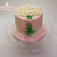 "Daisy Bouquet Retirement cake. 6"" with fondant daises."