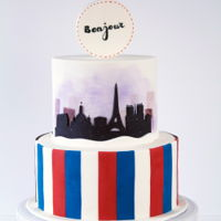 Double-Sided Cake Themed With France & Australia I Made this for my aussie friends who are moving to France. Printed city templates were used for the guideline of the top tier design....