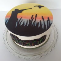 Duck Hunter Cake   Iced with buttercream, embellishments cut from rolled modeling chocolate (candy clay) using my Cricut.