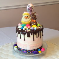 Easter Drip Cake  Chocolate devil's food cake with watercolour buttercream icing, chocolate ganache topping, assorted candy and chocolate decorations,...