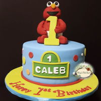 "Elmo 1St Birthday Elmo is made from fondant... used a Styrofoam ball for his body which helped to make the figure a lot taller (8"")"