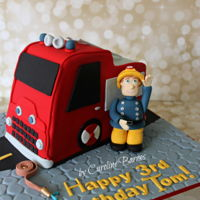 Fireman Sam Cake Carved Jupiter fire engine cake with hand crafted fondant Fireman Sam topper.