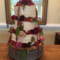 First Cake-- Flower Wedding This is my first cake job, so it was a little rough, but the bride wanted a rustic buttercream with fresh berries and real flowers. Each...