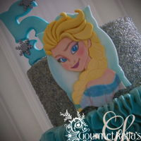 Frozen Birthday Cake SMBC decorated birthday cake! Elsa 2D figure made by modeling paste and handprinted face.
