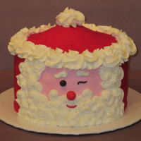 Happy Birthday Christmas Girl! Carved Santa Head with butter cream frosting.