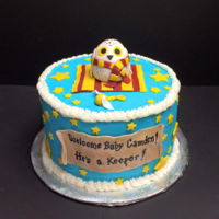 Harry Potter Themed Baby Shower Cake Featuring Baby Hedwig on a Gryffidor blanket with a snitch rattle.