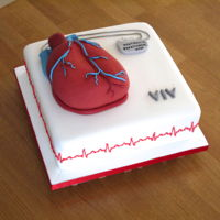 Heart And Pacemaker  The 'heart' is carved out of a 6 inch round madeira cake, placed on top of a 10 inch square plain sponge cake filled with vanilla...