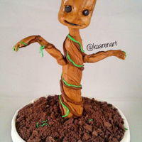 I Am Groot Baby Groot cake. Flower pot cake, chocolate cookie dirt, marshmallow fondant Groot.