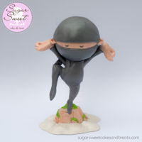 "Little Ninja Cake Topper  ""Ninja's pose up on their toes"" - a custom gumpaste cake topper I made of Little Ninja, a character off a children's..."