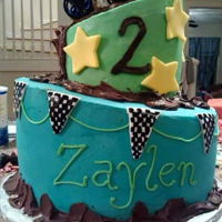 Monster Truck Topsy Turvy 2 tier Topsy Turvy cake, monster truck theme, buttercream and fondant decor. Truck is a toy.