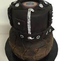 Motorcycle Club Cake I made this for my In-laws motorcycle club. The 'tire' tier was a dark chocolate cake with Cookies-n-Cream buttercream...
