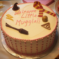 Muggle Baby Shower Cake Vanilla (white and pink marbled) cake with vanilla buttercream. Fondant decorations of various Harry Potter icons.