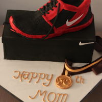 Nike Shoe Cake   I carved the show out of marble cake. The shoe,box and all the decor are comletely edible.