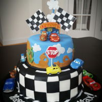 "Not A New Theme Here... My Take On ""cars"" Cake A birthday cake for a boy, cars theme. Yellow/pine-apple/cream top tier, chocolate/chocolate bottom tier. The clients provided the toys,..."