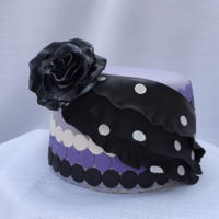 "Polka Dot Ruffle 6"" fondant covered cake with inlaid polka dot ruffle and black fondant/gumpaste rose."