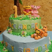 Pooh Piglet And Tigger Chocolate cake with fondant figure cake topper