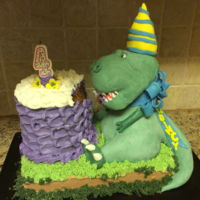 "Quincy's Dinasaur Cake ""Dinosaur"" is RKT. Cake and base are carrot cake with buttercream frosting."
