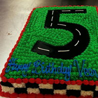 Race Car Track #5 Hand drawn # 5, #22 star tip around the 5. Flag on all sides of the cake using #22 star tip.
