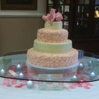 Roses And Pearls White Chocolate Sour Cream Cake with butter cream rosettes and pearls.