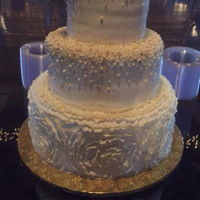 Ruffles And Gold I made my daughter's wedding cake which consisted of cream cheese pound cake, pink lemonade, and red velvet cake. Each tier was...