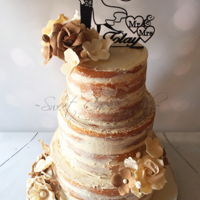 Rustic Naked Cake Rustic Naked Wedding cake with burlap sugar flowers.