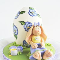 Sleepy Easter Bunny A little cake that I made last year for my daughter featuring a hand painted egg cake and a sweet little fondant Easter bunny who got a...
