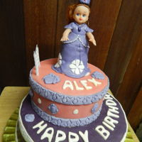 Sofia The First chocolate cake covered with buttercream and decorated with fondant, doll is decorated with fondant
