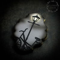 "Street Light Cookie Sugar cookie with Royal icing base and Silho cake lace for the light and bicycle, airbrushing for the ""light"" and around the..."
