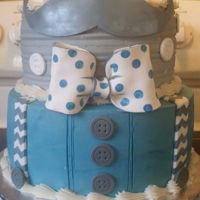 Suspenders & Mustache Baby Shower Cake 2 tier Baby Shower Cake, 10 & 8 inch round. Buttercream covered with fondant accent pieces.
