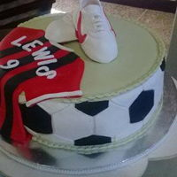 Sweet Sugar Shoes For A Footballer Groom A football themed Groom's cake complete with sugar football tugs.