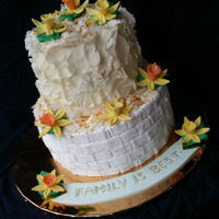 Tiered Cake   White cholate , tiered cake decorated with fondant flowers