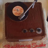 Turntable For The Groom Chocolate cake with peanut butter filling creates this turntable for the groom, who like vinyl albums. The cake is covered with chocolate...