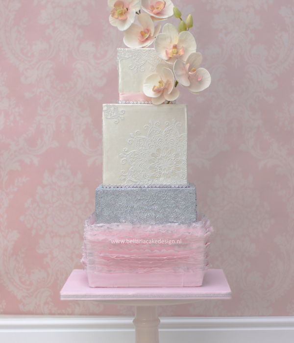 Soft Pink Ruffles Wedding Cake With Orchids
