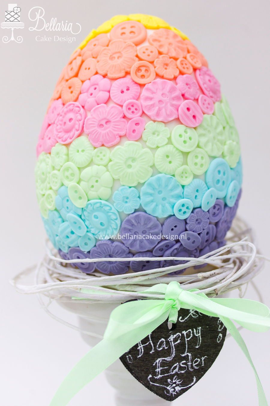 Pastel Buttons Easter Egg Cake CakeCentralcom