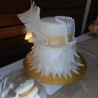 1920's Dessert Table White and gold 1920's theme. Flapper cake, cake pops and macaroons.