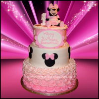 3 Tier Pink Disney Minnie Mouse 1St Birthday Cake With 3D Hand Sculptured Minnie Mouse Figure, Buttercream Rosettes. 3 Tier Pink Disney Minnie Mouse 1st Birthday Cake with 3D Hand Sculptured Minnie Mouse Figure, Fondant Minnie Mouse Heads, Buttercream...