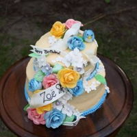 A Cinderella Wedding Gown Inspired Birthday Cake For Zoe This cake is a home made carrot cake covered in cream cheese vanilla bean frosting with gum paste flowers, bird, shoe and leaves. The trim...