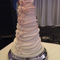 Bans Of Fondant And Umber At That!   A tall tower of fondant bans first and last time I do this cake. It took forever!