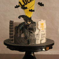 Batman! This is a Devils food chocolate cake with chocolate butter cream, covered with chocolate ganache.The The batman and the buildings are hand...