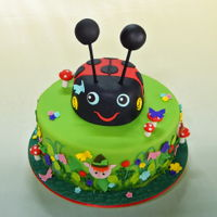 """ben & Holly's Little Kingdom"" Cake Chocolate cake, filled with ganache and iced with fondant and decorated with gum paste features."