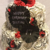 Black And Red Rosettes Red Velvet Cake with cream cheese butter cream. Fondant flowers.