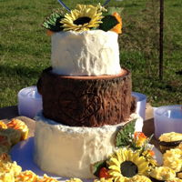 Buttercream Sunflower Wedding Cake buttercream cake with molding chocolate log and sunflowers
