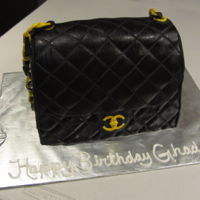 Chanel Purse Fondant covered vanilla cake. Added tylose in the gold chain to harden overnight and to be able to pass the black leather piece through....