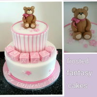 Christening Cake White and pink christening cake with a teddy bear, name blocks and blossom flowers