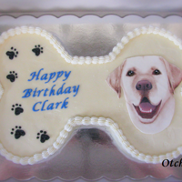 Clark's Birthday Cake  A bone shaped birthday cake for a sweet yellow lab. Cake is covered in SMBC and is decorated with a hand painted fondant decoration made to...