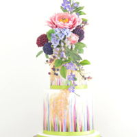 Colourful Cake With Flowers  Colourful painted cake in colours of the flowers and gold. Stencil and lace in gold. Flowers peony, periwinkle, pompon dahlia, some berries...
