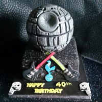 Death Star Cake A cake for a star wars fans, with a few of their favourite things incorporated into the design